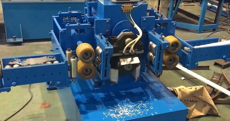mechanical punch hole device equipped with the roller up door machine